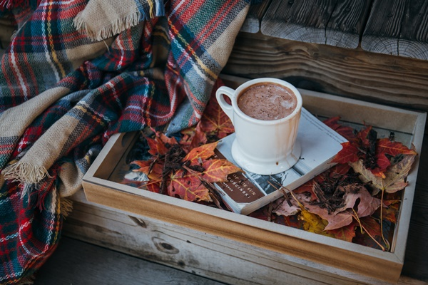 Autum wooden box with mug of cocoa and blanket