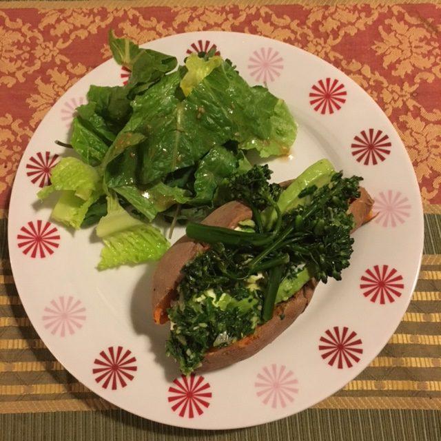 stuffed sweet potato on plate with salad