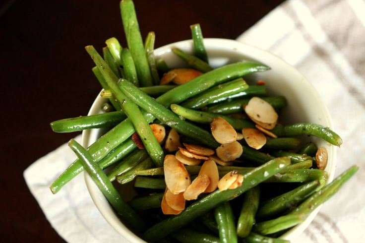 green beans in bowl with sliced almonds